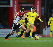 Nottingham Forest striker Nelson Oliveira taing on Brentford defender James Tarkowski during the Sky Bet Championship match between Brentford and Nottingham Forest at Griffin Park, London, England on 21 November 2015. Photo by Matthew Redman.