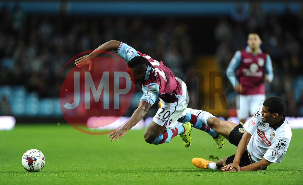 Adama Traore of Aston Villa is fouled by Mawouna  Amevor of Notts County  - Mandatory byline: Joe Meredith/JMP - 07966386802 - 25/08/2015 - FOOTBALL - Villa Park -Birmingham,England - Aston Villa v Notts County - Capital One Cup - Second Round