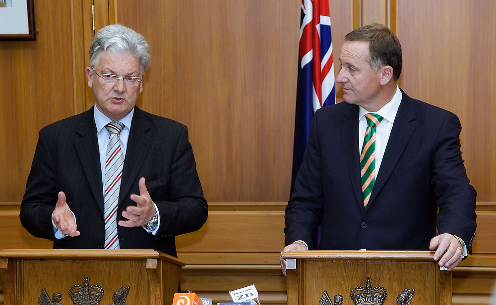 Peter Dunne, left leader of the United Future party  speaks to the media with Prime Minister of New Zealand John Key about a coalition agreement at Parliament in Wellington, New Zealand, Monday, December 05, 2011. Credit: SNPA / Marty Melville