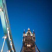 London's famous Tower Bridge at dusk. Constructed in the late 1800s, the ornate Tower Bridge is one of London's iconic landmarks. It gets its name from the nearby Tower of London on the northern bank of the River Thames. With copyspace.