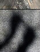 Mysterious shadows on a wall, mysteriöser geheimnisvoller Schatten auf einer Wand. Ombres misteriuex sur un mur. © Romano P. Riedo