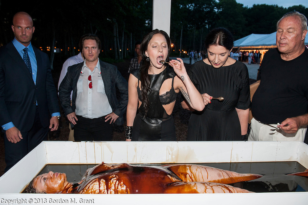 Water Mill, NY - 7/27/13 -  Lady Gaga, left, Marina Abramovic, center, and Robert Wilson, right, participate in an art installation at the 20th annual Watermill Center Summer Benefit in Water Mill, NY July 27, 2013. CREDIT: Gordon M. Grant for The Wall Street Journal<br /> NY.Devil'sHeaven