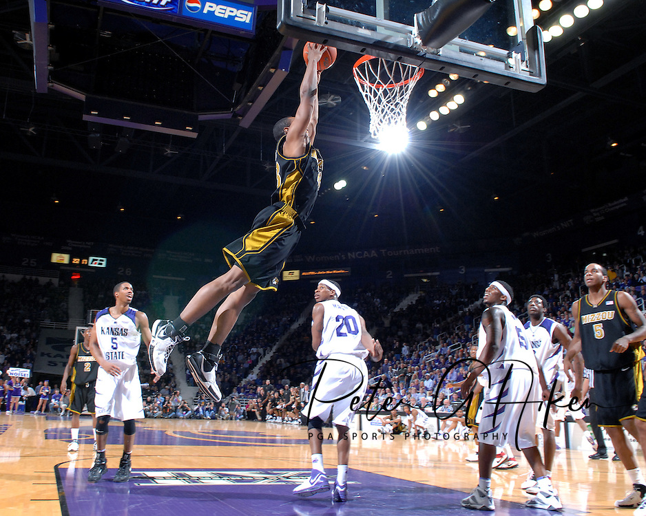 Missouri guard Marcus Watkins (C) flies in for the jam, as Kansas State's Cartier Martin (20), Clent Stewart (5) and David Hoskins (15) look on, during the first half at Bramlage Coliseum in Manhattan, Kansas, January 31, 2007.  K-State beat Missouri 80-73.