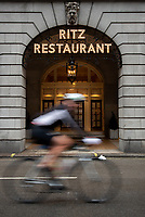 Cyclists ride past the entrance to The Ritz Hotel during The Prudential RideLondon Sportives. Sunday 29th July 2018<br /> <br /> Photo: Ben Queenborough for Prudential RideLondon<br /> <br /> Prudential RideLondon is the world's greatest festival of cycling, involving 100,000+ cyclists - from Olympic champions to a free family fun ride - riding in events over closed roads in London and Surrey over the weekend of 28th and 29th July 2018<br /> <br /> See www.PrudentialRideLondon.co.uk for more.<br /> <br /> For further information: media@londonmarathonevents.co.uk