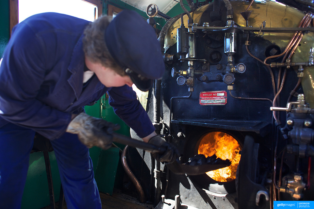 The fire is stoked on the Kingston Flyer vintage steam train, back in action and operating again after a three year break. The historic locomotives and carriages run daily for tourist between Kingston and Fairlight near Queenstown, Central Otago, New Zealand, 29th October 2011. Photo Tim Clayton...