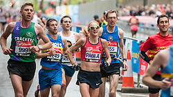 © Licensed to London News Pictures. 26/04/2015. London, UK. Paula Radcliffe , current world record holder, pictured at mile 13 on The Highway, competes in her final marathon. Photo credit : Stephen Chung/LNP