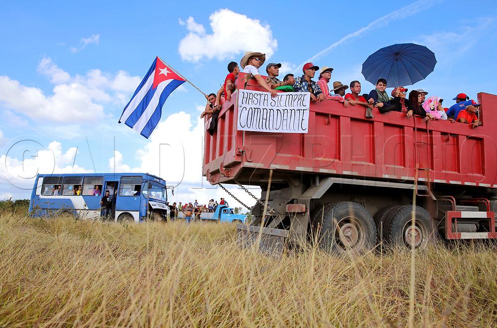 Cubans wait for the passage of Fidel Castro's ashes outside of Santa Clara, Cuba on Thursday, December 1, 2016.