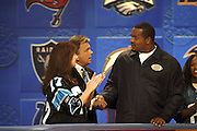 Show host Pat Sajak and a contestant with Carolina Panthers defensive tackle Kris Jenkins at NFL Players Week on Wheel of Fortune on 11/04/2003. ©Paul Anthony Spinelli/NFL Photos