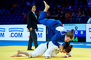 Warsaw, Poland - 2017 April 20: Helene Receveaux from France (white) competes with Theresa Stoll from Germany (blue) in the women&rsquo;s 57kg semifinal during European Judo Championships 2017 at Torwar Hall on April 20, 2017 in Warsaw, Poland.<br /> <br /> Mandatory credit:<br /> Photo by &copy; Adam Nurkiewicz / Mediasport<br /> <br /> Adam Nurkiewicz declares that he has no rights to the image of people at the photographs of his authorship.<br /> <br /> Picture also available in RAW (NEF) or TIFF format on special request.<br /> <br /> Any editorial, commercial or promotional use requires written permission from the author of image.