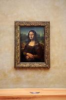 The Mona Lisa by Leonardo DaVinci at The Louvre, Paris, France.