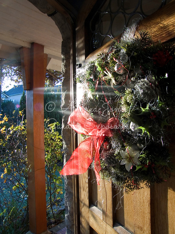 Front door with a Christmas wreath