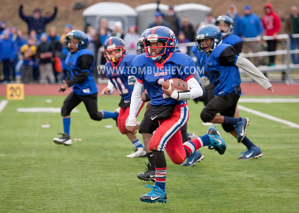 Newburgh, New York - A Goshen running back heads for the end zone in the Orange County Youth Football League Division II Super Bowl at Newburgh Free Academy on  Nov. 22, 2014.