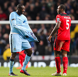 Manchester City's Yaya Toure gives his shirt to Wes Morgan of Leicester City  - Photo mandatory by-line: Matt McNulty/JMP - Mobile: 07966 386802 - 04/03/2015 - SPORT - football - Manchester - Etihad Stadium - Manchester City v Leicester City - Barclays Premier League