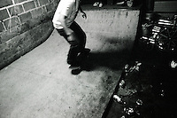 A skateboarder rides the mini-ramp past discarded beer cans and a broken wheelchair at the Danger Room......................