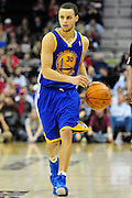 March 8, 2011; Cleveland, OH, USA; Golden State Warriors point guard Stephen Curry (30) drives down court during the fourth quarter against the Cleveland Cavaliers at Quicken Loans Arena. The Warriors beat the Cavaliers 95-85. Mandatory Credit: Jason Miller-US PRESSWIRE
