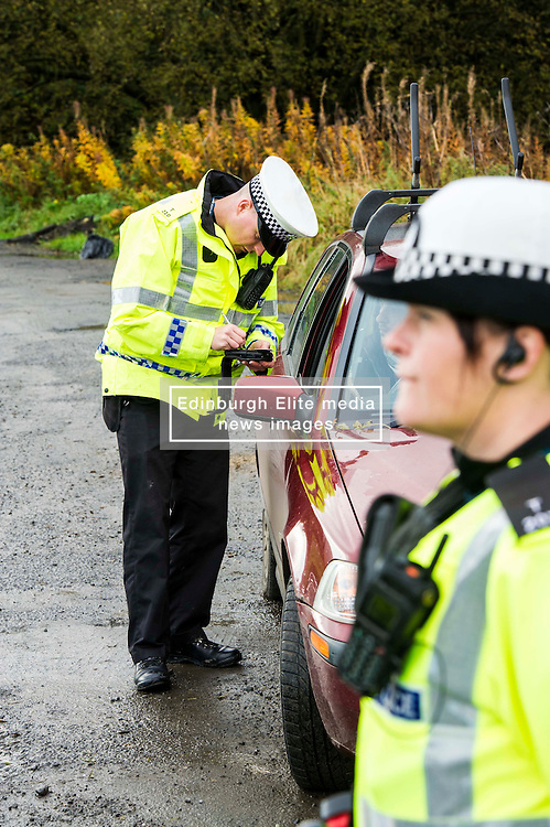 Pictured: PC Alan Meikle was making sure vehicles were safe for the coming winter.<br /> <br /> Police Scotland luanched a series of vehicle checks to be carried out by the Lothians and Scottish Borders Division Road Policing Unit. Inspector Roddie MacMillan oversaw the checks which are part of activity taking place across Scotland this week to help drivers get ready for winter, ensuring their vehicles are maintained and they are aware of the different hazards the changing seasons and weather can bring. <br /> <br /> Ger Harley | EEm 18 October 2016