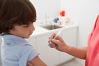 Boy receiving injection