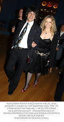 Rolling Stone RONNIE WOOD and his wife JO, at an exhibition in London on 16th September 2003.PMK 175