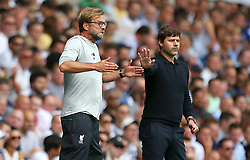 File photo dated 27-08-2016 of Liverpool manager Jurgen Klopp (left) and Tottenham Hotspur manager Mauricio Pochettino during the Premier League match at White Hart Lane, London.