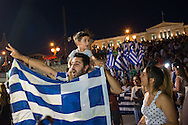 Athens, 05/07/2015: People celebrate in front of the Greek parliament the win for the Oxi, or No, in the Greek referendum, Syntagma square.