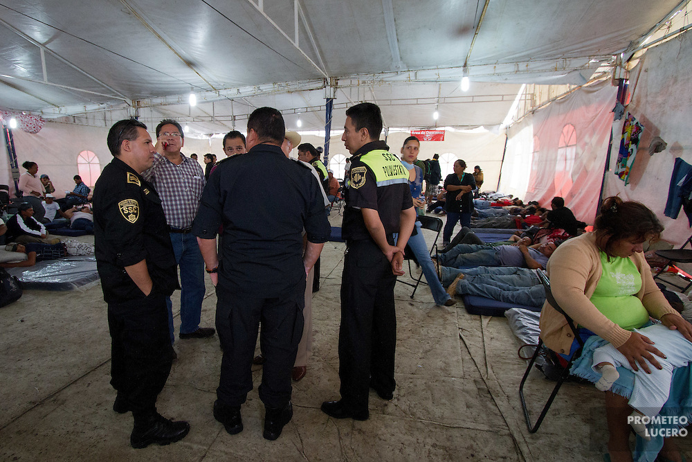 "State police officers and local authorities stand inside the migrants temporary shelter in Tultitlán before asking migrants to leave the place, on on August 3rd, 2012. Tultitlán local authorithies ordered to dismantle the temporary shelter that was placed under a bridge in Tultitlán after shelter  ""San Juan Diego Cuauhtlatoatzin"" in Lecheria, was closed on July 9th, 2012. (Photo: Prometeo Lucero)"