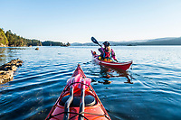 A first person perspective of two people sea kayaking on the west side of Wallace Island Marine Provincial Park in the Gulf Islands, British Columbia, Canada.