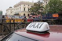 Polish taxi sign seen near the train station in Krakow Poland