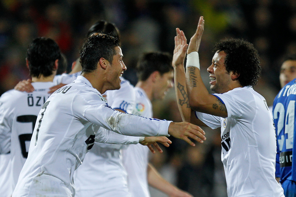 Real Madrid's Cristiano Ronaldo from Portugal, left, reacts after scoring against Getafe with Marcelo from Brazil, right, during their La Liga soccer match at the Coliseum Alfonso Perez stadium in Getafe, near Madrid, on Monday, Jan. 3, 2011.