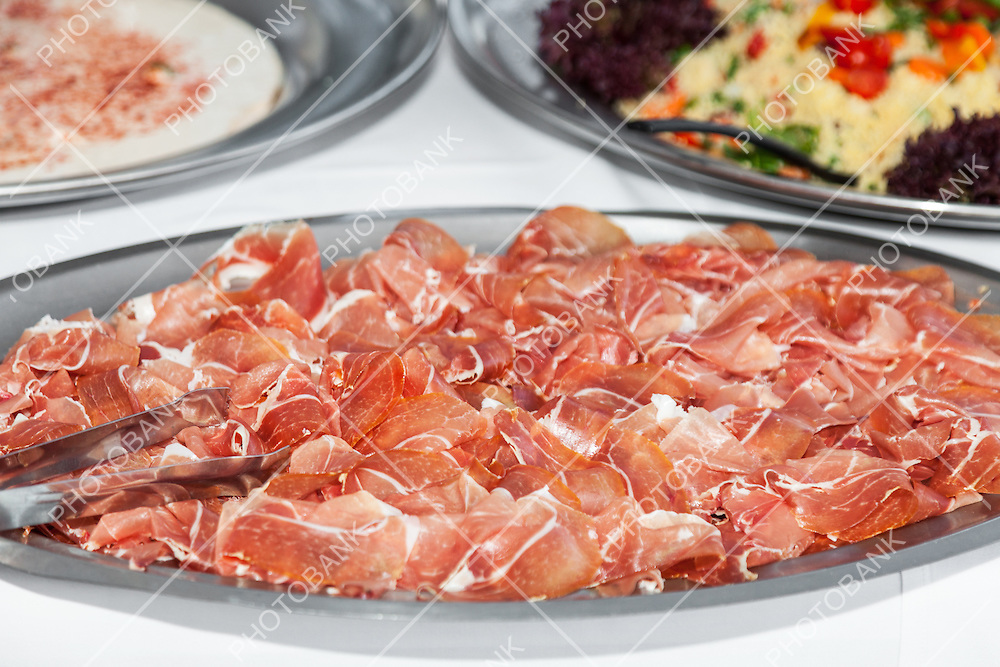party outdoors, tasty appetizer, plate of ham