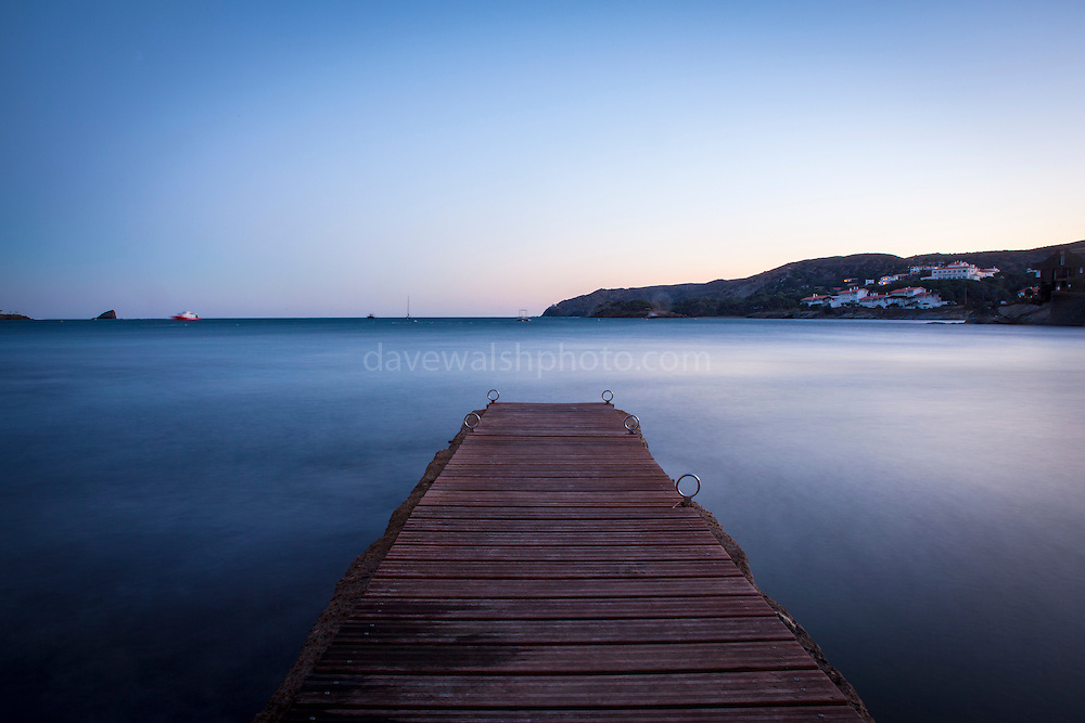 "Long exposure, December light falls on the harbour jetty in Cadaqués, Catalonia. This mage can be licensed via Millennium Images. Contact me for more details, or email mail@milim.com For prints, contact me, or click ""add to cart"" to some standard print options."