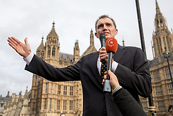 © Licensed to London News Pictures. 23/11/2016. London, UK. Conservative MP for Monmouth David Davies campaigns with demonstrators outside the Houses of Parliament for a 'hard Brexit' on the day Chancellor of the Exchequer Philip Hammond releases the autumn statement. Photo credit : Tom Nicholson/LNP