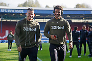 Leeds United midfielder Kalvin Phillips (23) and Leeds United forward Tyler Roberts (11) share a joke during the EFL Sky Bet Championship match between Blackburn Rovers and Leeds United at Ewood Park, Blackburn, England on 20 October 2018.