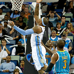 October 29, 2010; New Orleans, LA, USA; Denver Nuggets small forward Carmelo Anthony (15) shoots over New Orleans Hornets center Emeka Okafor (50) during the third quarter at the New Orleans Arena.  Mandatory Credit: Derick E. Hingle