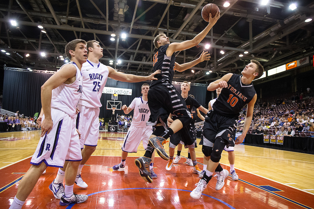 GABE GREEN/Press<br /> <br /> Post Falls&rsquo; Corey Koski attempts a layup Thursday against Rocky Mountain during the team&rsquo;s first game in the 2014 5A state tournament.
