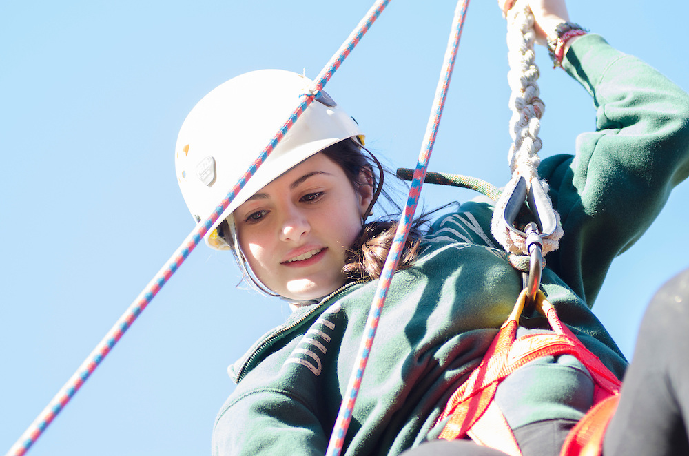 Clare Palo waits to be assisted off the zipline located at the Outdoor Pursuits challege course in the Ridges of Athens, Ohio. Palo came to the zipline with her father as a part of Ohio University's Dad's Weekend.
