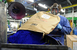 An AkzoNobel employee adds blue pigment to a new batch of paint at the paint production facility in Sassenheim, the Netherlands, Wednesday, Dec. 22, 2010. (Photo © Jock Fistick)
