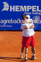 Martin Klizan (SVK) and David Marrero (ESP) celebrate after a tennis match against the Nicholas Monroe (USA) and Simon Stadler (GER) in final of doubles at 24. ATP Vegeta Croatia Open 2013, on July 27, 2013, in Umag, Croatia. (Photo by Urban Urbanc / Sportida.com)