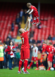 LIVERPOOL, ENGLAND - Sunday, May 11, 2014: Liverpool's Martin Skrtel throws his son Matteo up in the air after the final game of the Premiership season at Anfield. (Pic by David Rawcliffe/Propaganda)