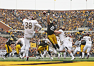 November 21, 2009: Iowa's Paki O'Meara (25) tries to get a hand on a punt by Minnesota punter Blake Haudan (38) during the second half of the Iowa Hawkeyes 12-0 win over the Minnesota Golden Gophers at Kinnick Stadium in Iowa City, Iowa on November 21, 2009.