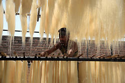 May 4, 2019 - Allahabad, Uttar Pradesh, India - Allahabad: An Indian worker drying vermicelli at a factory ahead of Ramadan month in Allahabad on May 04, 2019. Vermicelli used to make a traditional sweet dish popular during the fasting month Ramadan. (Credit Image: © Prabhat Kumar Verma/ZUMA Wire)