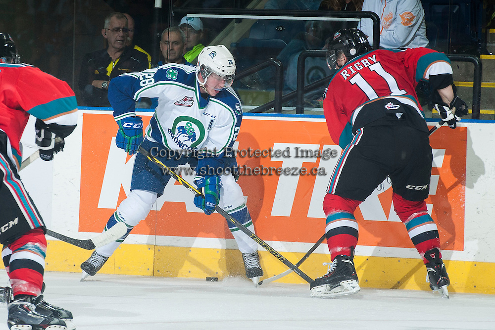 KELOWNA, CANADA - OCTOBER 7: Carter Rigby #11 of Kelowna Rockets digs for the puck against Coda Gordon #28 of the Swift Current Broncos on October 7, 2014 at Prospera Place in Kelowna, British Columbia, Canada.  (Photo by Marissa Baecker/Getty Images)  *** Local Caption *** Carter Rigby; Coda Gordon;