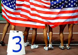 01-09-2007 ATLETIEK:  IAAF WORLD CHAMPIONSHIPS: OSAKA JAPAN<br /> 4 x 100 meter Estafette - USA met Lauryn Williams, Allyson Felix, Mikele Barber en Torri Edwards wint goud - creative illustratief Atletiek vlag<br /> ©2007-WWW.FOTOHOOGENDOORN.NL