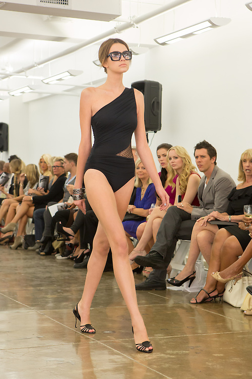Black one-shoulder swimsuit with lace inset at the waist. By Carmen Marc Valvo at the Spring 2013 Fashion Week show in New York.