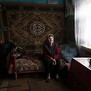 A blind elderly woman her house in Vyzovka, where many families were relocated after Chernobyl's disaster.