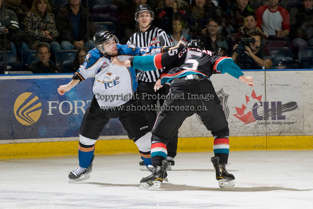 KELOWNA, CANADA, NOVEMBER 25: Brendan Hurley #25 of the Kootenay Ice gets in the face of Mitchell Chapman #5 of the Kelowna Rockets as the Kootenay Ice visit the Kelowna Rockets  on November 25, 2011 at Prospera Place in Kelowna, British Columbia, Canada (Photo by Marissa Baecker/Shoot the Breeze) *** Local Caption *** Brendan Hurley; Mitchell Chapman;