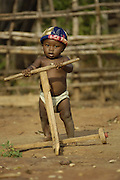 Child learning to use a home-made walker.<br />