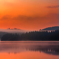 Calm lake in the colors of afterglow