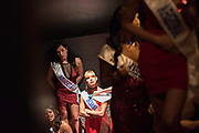 LOS ANGELES, CA - OCTOBER 22, 2016:  <br /> <br /> Mireya Orozco (Minnesota) and Hayden Nicole Rife<br /> (Indiana) wait in a stairwell with the other contestants, waiting to make their grand entrance at the Transnation Queen USA 2016 pageant, a transgender beauty pageant held at The Theater at The Ace Hotel in downtown Los Angeles.<br /> <br /> (Melissa Lyttle for The Guardian)