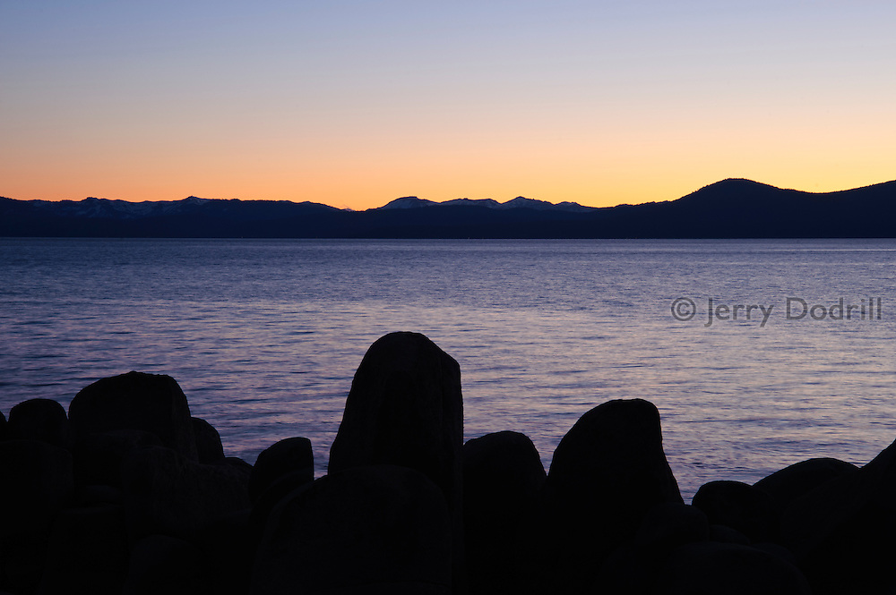 Twilight at Memorial Point, on Lake Tahoe's NE shore. Lake Tahoe is a large freshwater lake in the Sierra Nevada mountain range on the California/Nevada Border. At a surface elevation of 6,225 ft Lake Tahoe is the largest alpine lake in North America with a epth of 1,645 ft.