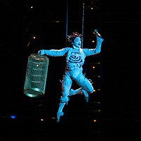 London, UK - 4 Janaury 2014: Ardee Dionisio as The Target performs on stage during the dress rehearsal of Quidam at the Royal Albert Hall. (available only for editorial coverage of the Production)